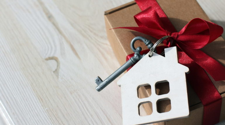 gift tied with a key and a house
